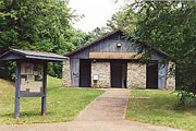 a picture of one of the buildings, and the wide handicapped accessible path, at Clark Creek North Campground, Lake Allatoona