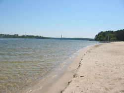 the shoreline of the swimming beach